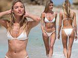 Martha Hunt flaunts her beach body in a tiny white bikini