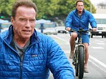 Arnold Schwarzenegger looks happy to be riding a bike in LA just two months after open-heart surgery