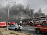 Massive fire rages through a Brooklyn mall parking garage as multiple cars are ablaze