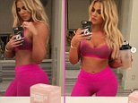 Khloe Kardashian shows off sculpted abs in hot pink sportswear