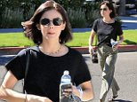 Lucy Hale displays her casual fashion sense in black tee and pants as she enjoys a day out in LA